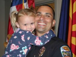 Arizona Policeman, Brian Zach Adopts Girl he comforted During Duty